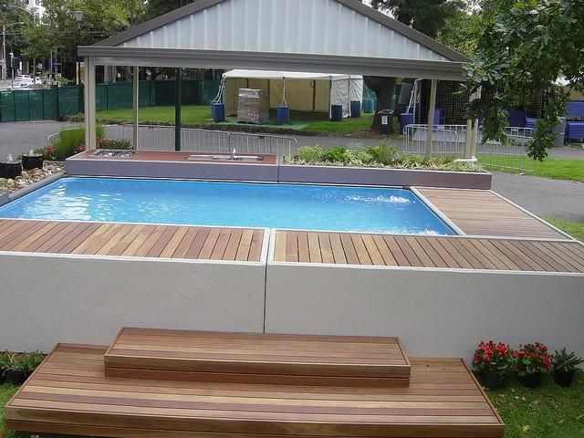 Above Ground Swimming Pool Cost  Stunning above ground concrete pools better looking