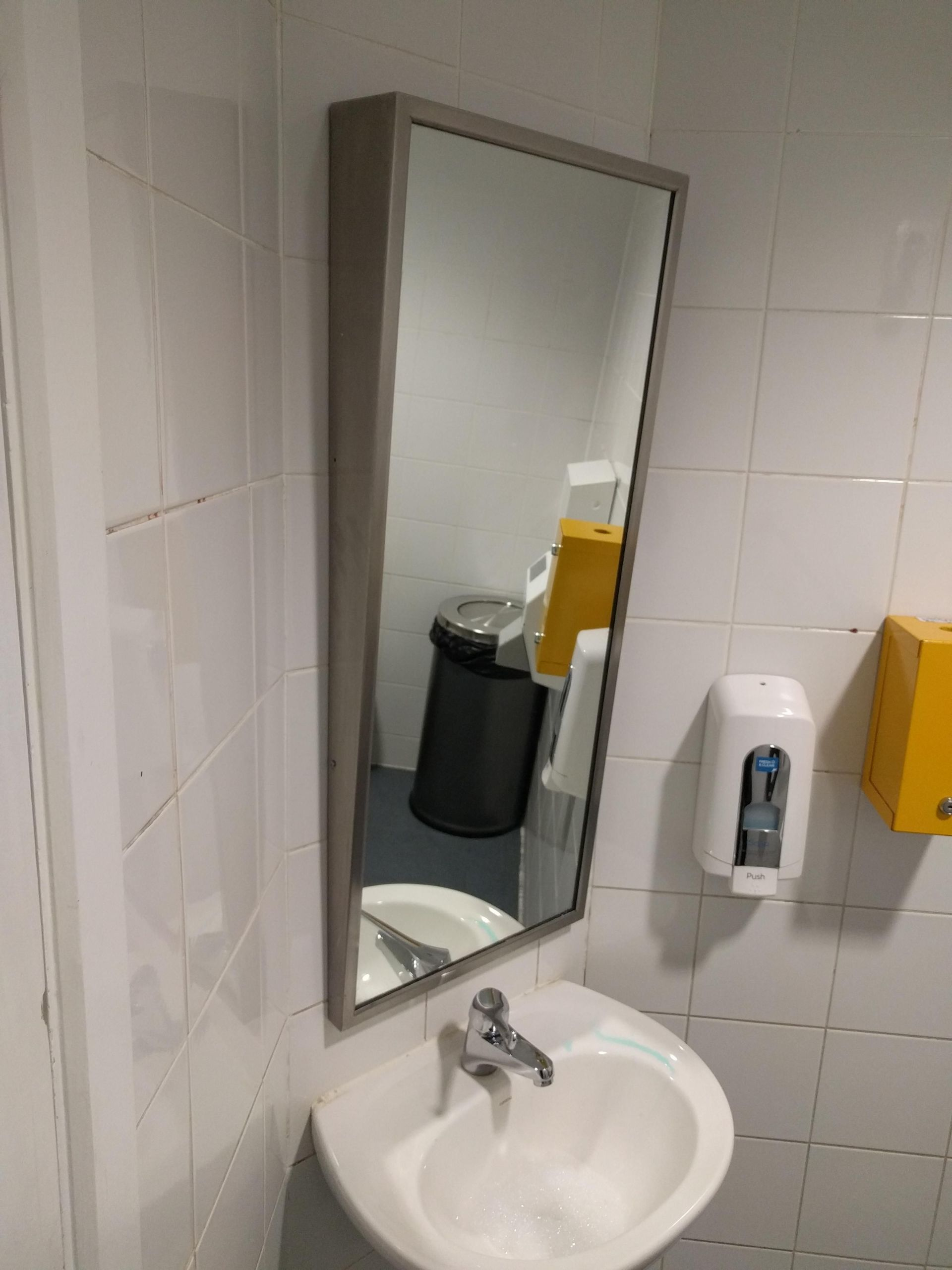 Ada Bathroom Mirror Height  This mirror in a disabled toilet is angled downwards for