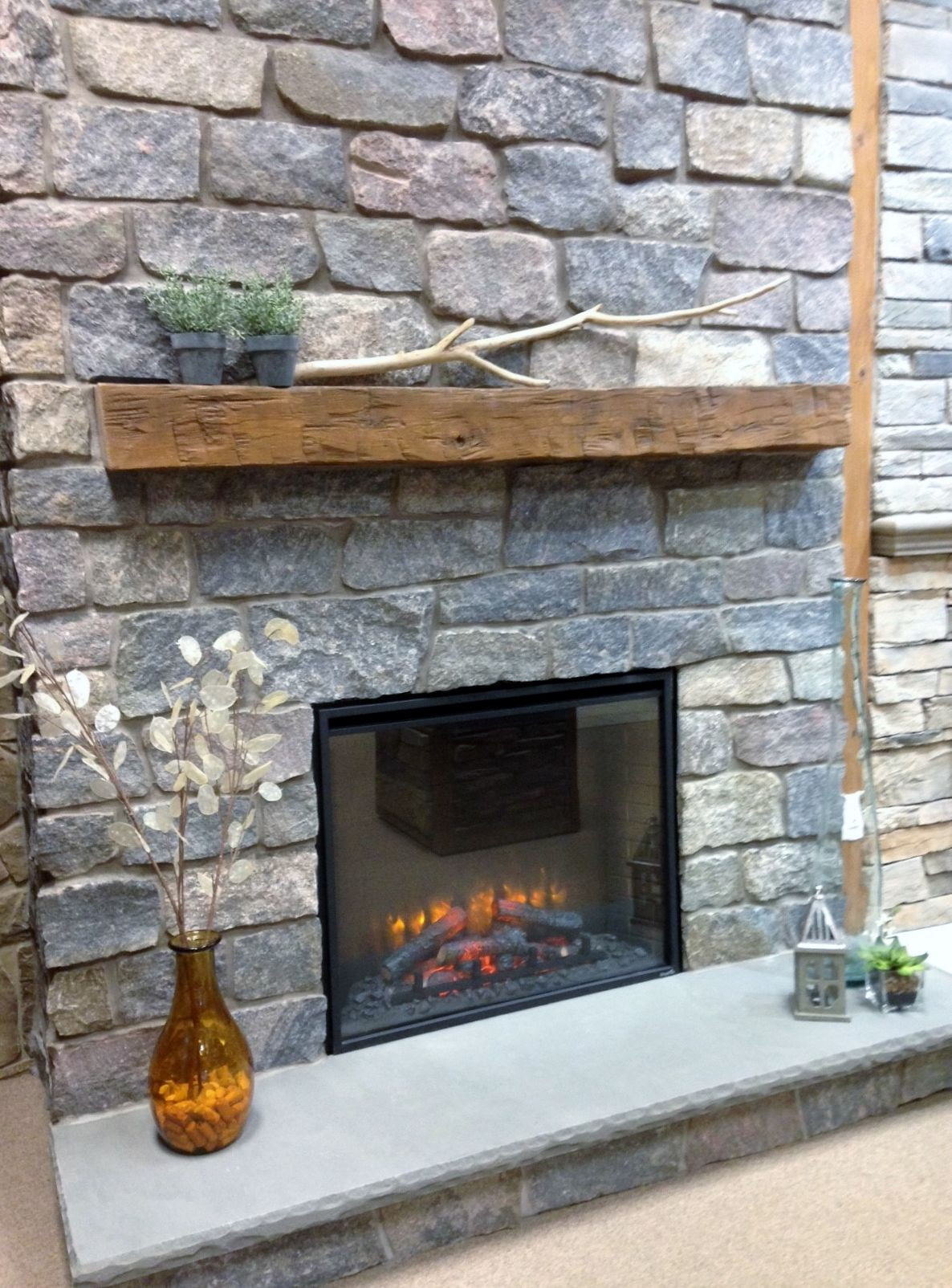 Blue Electric Fireplace  Quarry Cut Natural Stone Fireplace Surround Barn Beam