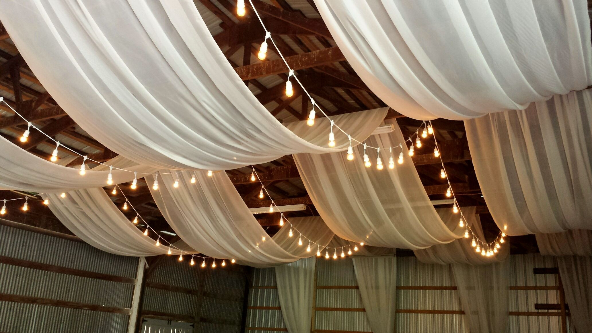 DIY Draping For Wedding  Ceiling draping in a barn This makes a rustic wedding