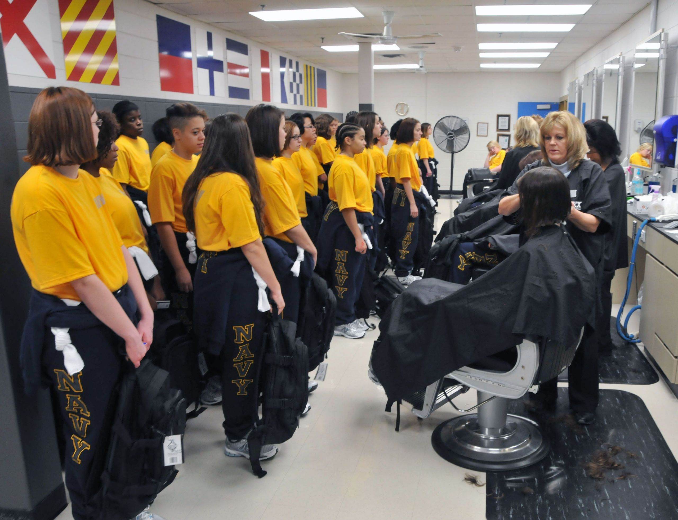 Female Navy Haircuts  New female recruits receive their first haircuts at the