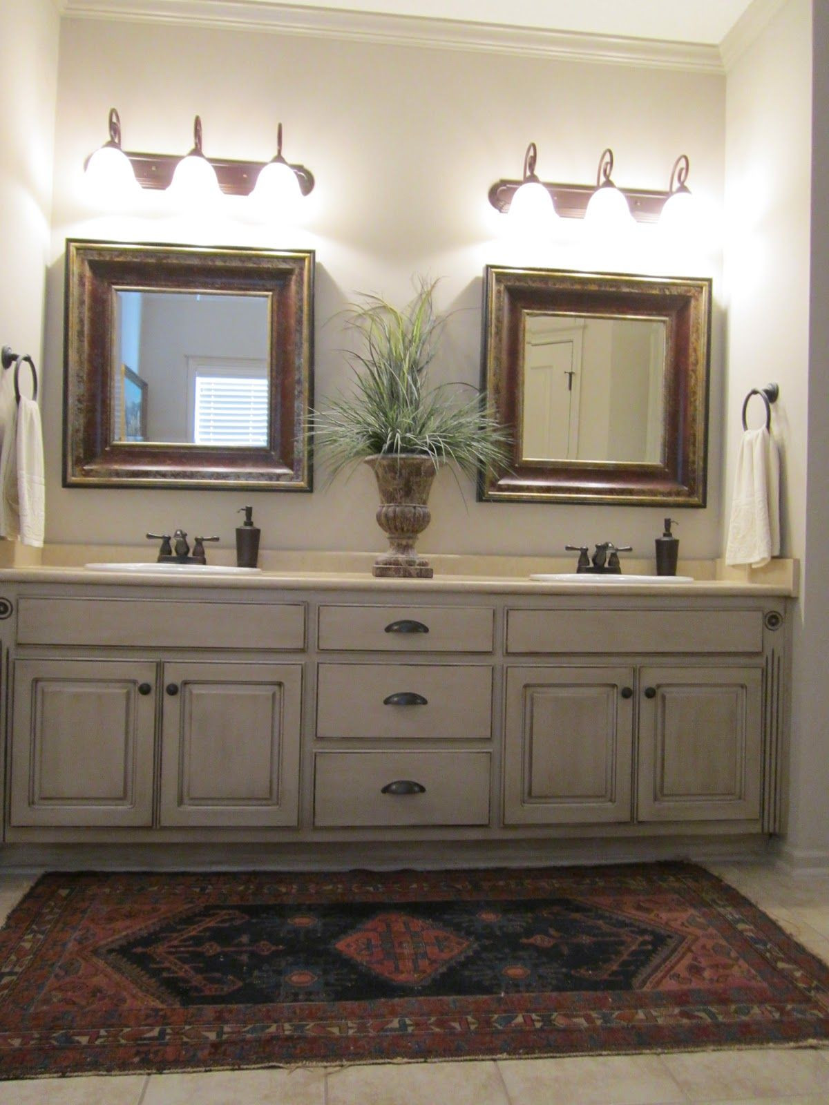 Painting Bathroom Cabinets  Love these painted bathroom cabinets and the lights What