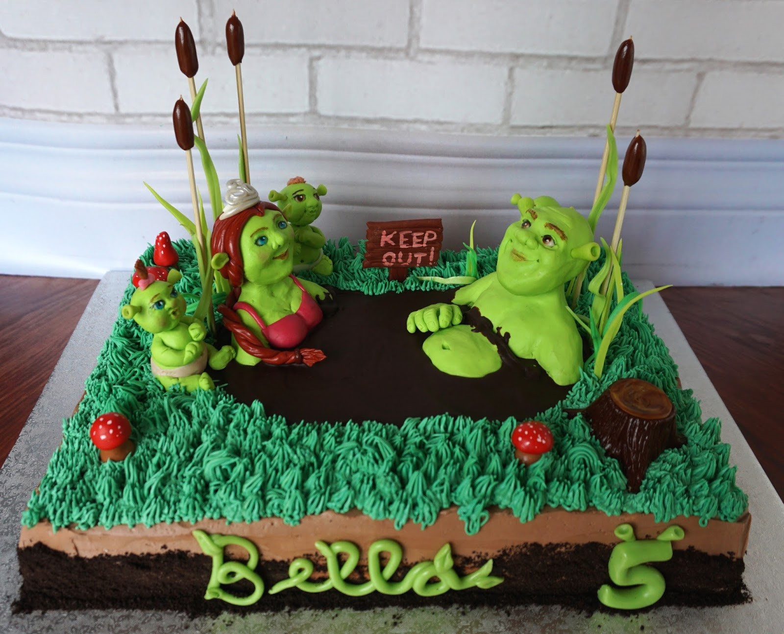 Shrek Birthday Cake  Custom Cakes by Lori Shrek family cake in a mud bath for